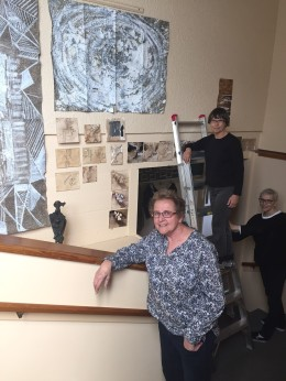 Shirley Grosser with her work and valued assistants including Ulrike Walker, who is also showing her work at the gallery.