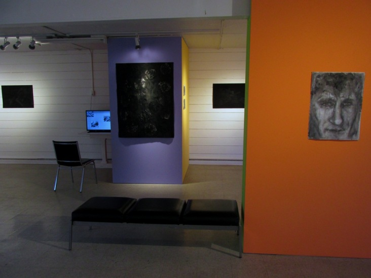 """Installation view with""""Red Orchestra"""" and """"Jack,"""" including a video by Ira Hoffecker and drawings by Ulricke Walker."""